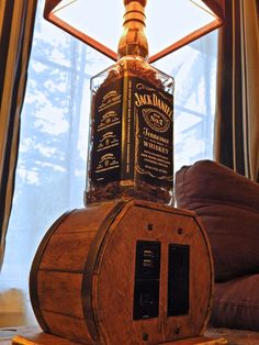 Jack Daniels Bottle Lamp with USB, outlet and light switch. How clever is this? #jackdaniels #bottlelamp