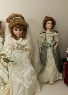 "Porcelain dolls including ""Orlena Siegel"", four ""Franklin heirloom"", ""Dynasty Doll"", with other marked and unmarked dolls with accessories. Over 20 dolls total."