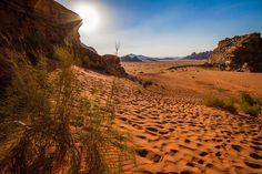 The sun prepares to set in the Wadi Rum desert of Jordan.