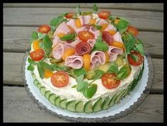 "smorgastarta - A ""Sandwich Cake"" put whatever you want in it, great way to serve sandwiches at a party"