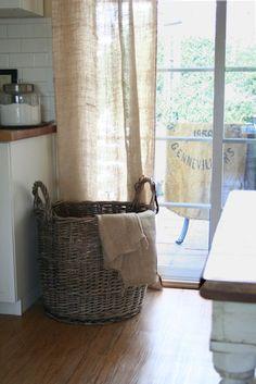 I like the idea of tossed sacks creating a Paris flea market feel. I like the idea of burlap sacks used in decorating