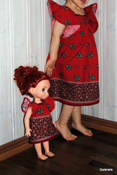 Little girl´s and Disney Animator doll´s dresses from old cotton curtains