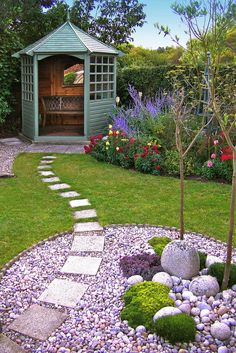 https://flic.kr/p/bhvYRv | Garden design | Path leading to gazebo cuts across pebbled circle with thrift, sedum and saxifrage planting.