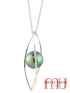 French Polynesian top green pearl pendant. An 18ct white gold three bar twist cage entraps the single natural green pearl, suspended on a fine white gold chain. Custom made in the Metal Urges workshop, Tasmania.