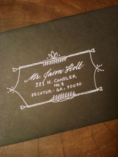 white ink on a rich brown envelope | calligraphy address