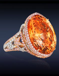 Ceylon Sapphire Cocktail Ring, Featuring A Breathtaking AGL Certified 46.64 Ct Oval Cut Natural Orange Sapphire (Untreated) Highlighted With 2.17 Ct Natural Fancy Intense Pink Diamonds & 0.72 Ct White Diamonds Delicately Set in a Pave' Setting, Mounted in Platinum & 18K Rose Gold.