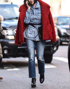 street style woman wearing all denim with a fur coat