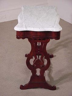 This Walnut Victorian Table Has A Shapely Marble Top. The Sides And Bottom  Shelf Have