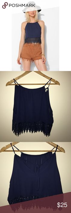 UO Staring At Stars Tunnel Crochet-Trim Tank Top Breezy chiffon tank top from Staring at Stars with teardrop lace trim along the hem. Cut in a drapey silhouette with a gathered neckline that ties at the back. Lightweight; semi sheer. Size Medium, Navy blue. Staring at Stars Tops Tank Tops