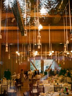 Candles in mason jars hanging from ceiling
