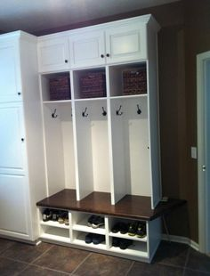 Mud room ~ like the cabinet storage at side for broom, mop, etc.