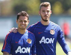 Javier Hernandez (left) and David de Gea (right) were all smiles as they were pictured in Manchester United training on Monday
