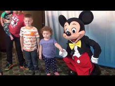 Mickey enjoying some time meeting with some young guests.