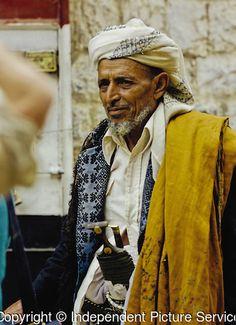 Portrait of a Yemeni man wearing a traditional keffiyeh, shoulder mantle, and displaying a jambiya, Hajjah, Yemen