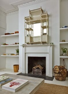 House in London; Looks like an old dolls house has been made into a mirror mantle piece,