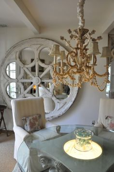 I Love this!  Almost as great as a large clock Face. The Green Room Interiors Chattanooga, TN: Designing with Architectural Salvage
