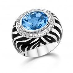 Get in touch with your wild side with this Raquelle Bianco Sterling Silver Zebra Enamel Ring with Large Blue Topaz from our Animal Instincts Collection! Mix and match our different animal print enamel rings and bangles together to make really bring out your natural instincts! Repin to your own style inspiration board!