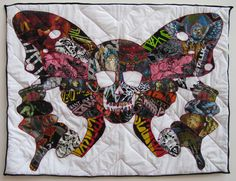 baby quilt out of old metal tshirts.  go ahead @Rachel Valosik and get knocked up so i can make you one of these.