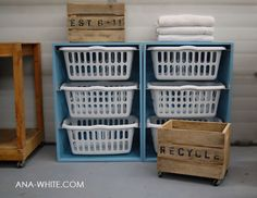 Purchase laundry baskets of the same size, build a  box with internal shelves to hold them.  Add wheels to the bottom to roll near washer.