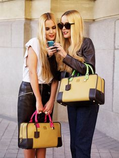Spanish Golden Age Loewe Oro 2012 Collection   Sisters Helena and Lucia Cuesta with the Oro grained calf Amazona with magenta fluor and green fluor handles