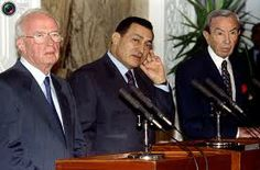 Secretary of State Warren Christopher look on during a news conference in Cairo in this June 9, 1995 file photograph. Egypt's Vice President Omar Suleiman ...