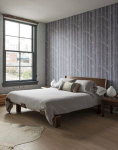 http://www.remodelista.com/posts/dumbo-brooklyn-family-loft-designed-by-alloy-and-rebecca-robertson-marco-pasanella  Serenity reigns in the master bedroom, which has a wall of Cole & Son Woods wallpaper.