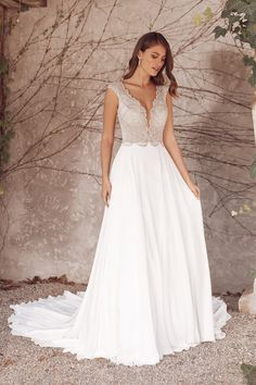 Dance the night away in this sparkly A-line wedding gown. The hand-beaded bodice has a slim illusion neckline with a scalloped trim. Cap sleeves lead into an open back. A chiffon skirt makes this piece flowy and fun. Corsage, Bridal Gowns, Wedding Gowns, Wedding Bells, Justin Alexander Bridal, Bride Dress Simple, Bridal Gallery, Prom Dress Shopping, A Line Gown