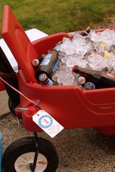 Drinks on ice in plastic wagon. Great idea for children's party.