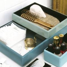 Stack varying sizes of trays in your bathroom to contain your toiletries. Not only will your mess of beauty products look polished, but the trays will slide across for easy access. Source