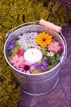 Floral Bucket Centerpiece: For an outdoor wedding or a garden party, why not try something a bit rustic to complement your theme? Place flower heads in a bucket filled with water and use them as aisle decor.