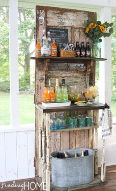 Another use for an old door: turn it into a  beverage station by adding shelves and some pretty vintage brackets. This could easily be a hall tree or potting station as well. This pretty one is by Finding Home.
