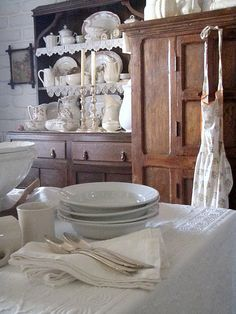 love the rustic and cottage together... note the silver candlestick on the shelf.. beautiful