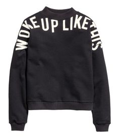 Text-print sweatshirt with dropped shoulders and long sleeves. Black & white. | H&M Divided