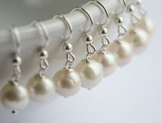 bridesmaid gifts,Set of 5,Wire wrapped pearls,gold earrings,bridal jewelry,wedding jewelry,wedding party gift,mothers gift. $85.00, via Etsy.