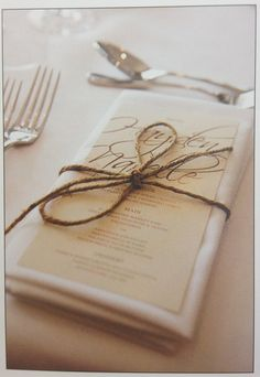 place setting: tweed or twine tied in a bow, with the menu printed and placed on the napkin. Great natural/neutral colors