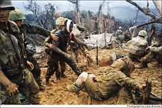 """""""Reaching Out"""" by Larry Burrows, south of the DMZ, 1966. Burrows himself was killed when a helicopter he was riding in was shot down over Laos in 1971."""
