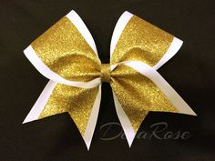 Hey, I found this really awesome Etsy listing at https://www.etsy.com/listing/222198405/white-and-gold-glitter-cheer-bow-sports