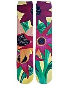This is a painting of sunflowers on a pair of knee high socks.