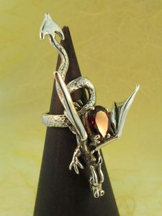 Marty Magic Store - Sculpture Dragon Ring With Garnet, $445.00 (http://www.martymagic.com/sculpture-dragon-ring-with-garnet/)