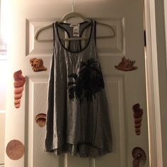 NWT Fun Palm Tree Racer Back Tank NWT Fun Racer Back Tank From Ginger G. This tank will keep u cool in the summer. Color is Gray with black Palm tree print on front. Hi low hem. Size: Small. 94% rayon. 6% spandex. Hand wash. Line dry. NO TRADES. Ginger G Tops Tank Tops