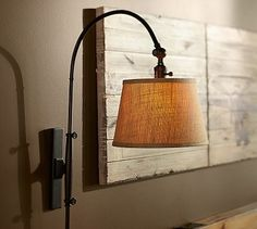 Adjustable Arc Sconce #potterybarn I like this a lot but its $240 for two.  Nice look and adjustable!