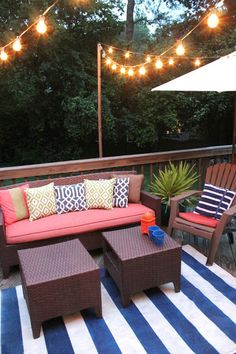 The string of lights was one of the first projects we did when we moved in. We just nailed in some 2x2's to the railing to give them something to hook to on the opposite side of the house.  - southern state of mind: Our Back Porch is (finally) Ready for Summer