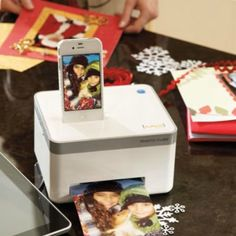 Hard to believe now that we hardly ever print anything, but personal printers used to take up an entire desk — there were even tables and rooms specifically for them! The Compact Photo Cube Printer ($150), acts as an iPhone dock to print pics in