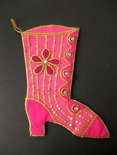 """Vintage 1960s pink Christmas stocking was hand made in the 1960's in a Victorian boot shoe design with gold metallic trim and crystal buttons on heavyweight felt. 16"""" tall from top to bottom of heel, 12"""" across from back of heel to toe. Back is solid pink; gold trim loop to hang."""