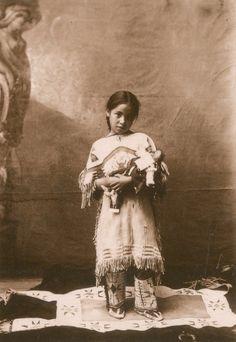Katie Roubideaux. A Sičháŋǧu Oyáte (Brule Sioux) girl. 1898. Rosebud Indian Reservation, South Dakota. Photo by J.A. Anderson.