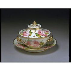 Sauce tureen with cover and stand Place of origin:Swansea, Wales (made)  London, England (decorated)Date:1814-1826 (made)Artist/Maker:Swansea Pottery (manufacturer)  Robins and Randall (decorator)Materials and Techniques:Soft-paste porcelain painted with enamels, gilded and moulded