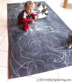 How to Make a Kids DIY Chalk Board ~ I love the chalkboard as a rug.  What a fun way for kids to really get into their work.