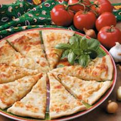"""Garlic Onion Focaccia Recipe -I use my bread machine to prepare the dough for this savory Italian flat bread. It's a great addition to any meal. At times, I make it for myself as a main-dish """"pizza"""".                                -Cindy Cameron                                 Omaha, Nebraska"""
