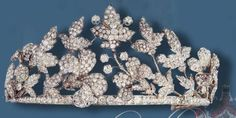 From what I can gether this tiara originally started out life as a diamond necklace belonging to the Prussian Royla Family. It was remodelled into a floral tiara by Chaumet in 1933 on the orders of the Duke of Sangro, an Italian Nobleman. Image courtesy of Ursula's Royal Magazin site.