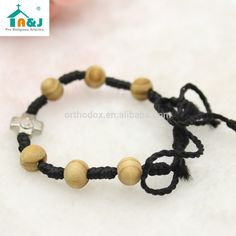 Olive Wood Beads Knotted Thread Rosary Bracelet , Find Complete Details about Olive Wood Beads Knotted Thread Rosary Bracelet,Olive Wood Rosary Bracelet,Knotted Thread Rosary Bracelet,Olive Wood Knotted Rosary Bracelet from -Ningbo Zhenrong Int'l Trading Ltd. Supplier or Manufacturer on Alibaba.com